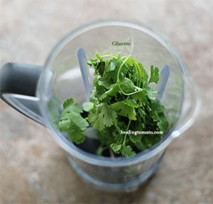 Overhead view of cilantro in a blender - Pressure Cooker Corn on the Cob