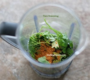 Taco Seasoning inside a blender with cilantro - Pressure Cooker Corn on the Cob