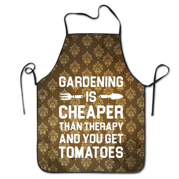 "Apron with words ""Gardening is cheaper than therapy and you get tomatoes"" - 10 Gag Gifts to Give Tomato Lovers"