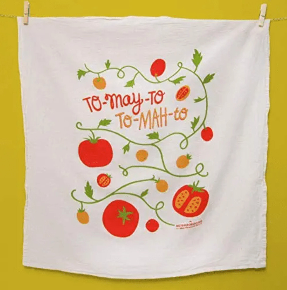 Tomayto and tomato written on a white dish towel with tomatoes draw on it