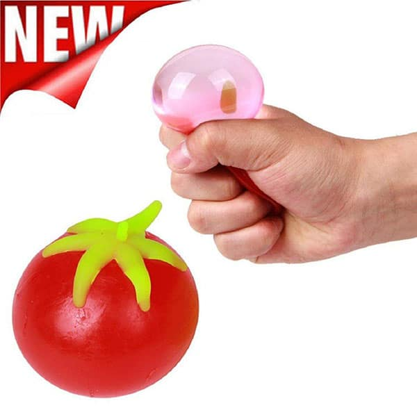 Tomato squeeze toy and an image of a hand squeezing the toy - 10 Gag Gifts to Give Tomato Lovers