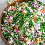 Overhead view of a brown bowl filled to the top with Amaranth Tabouli