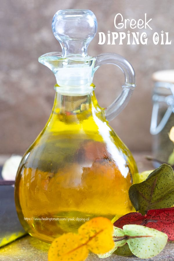 Front view of a glass olive oil bottle filled with Greek Extra Virgin Olive OIl - Greek Dipping oil