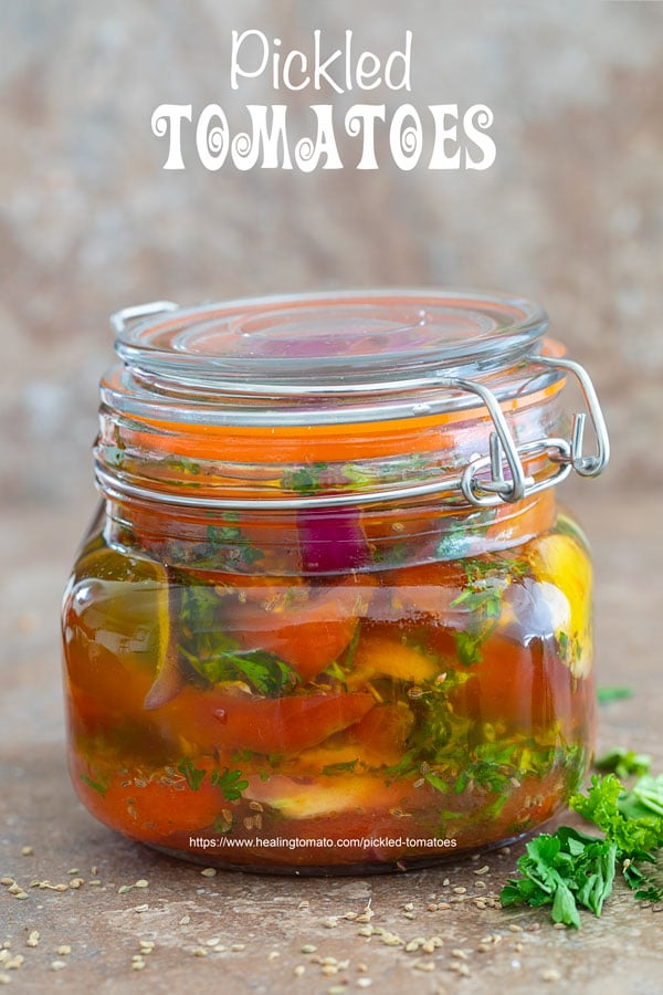 Pickled tomatoes in a mason jar - preserving tomatoes