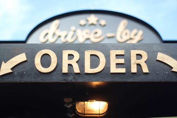 Sign that says drive-by and order