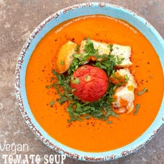 Overhead view of a blue bowl with healing tomato soup
