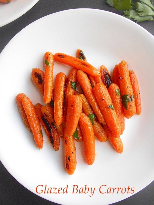 Roasted Carrots on a white plate - Thank Vegans