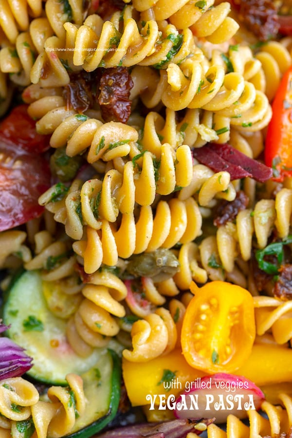 Overhead view of vegan pasta with grilled veggies.