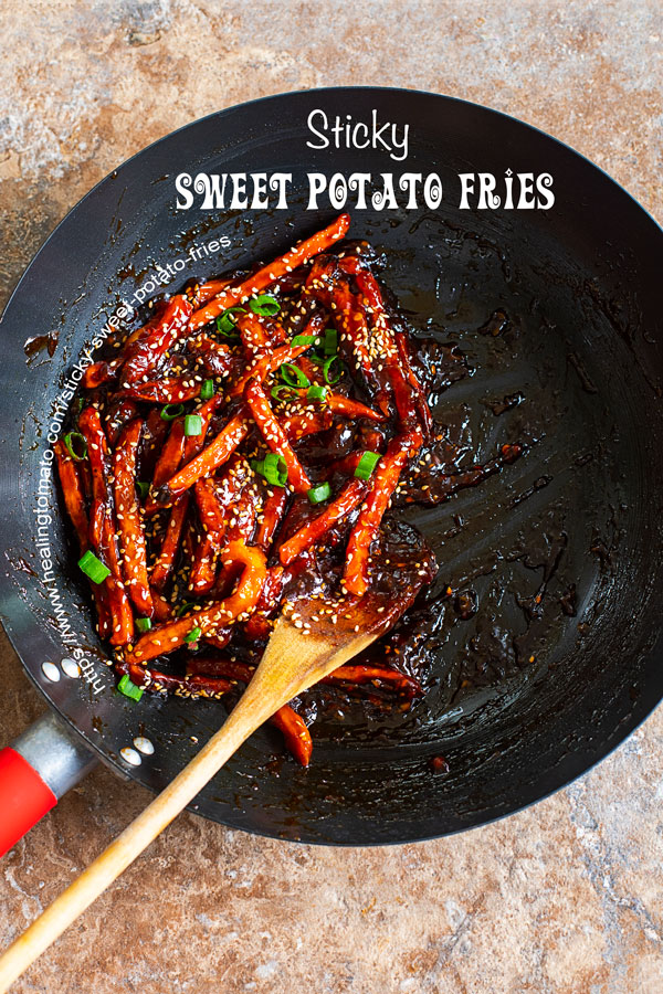 overhead view of sticky sweet potato fries in a jumbo wok