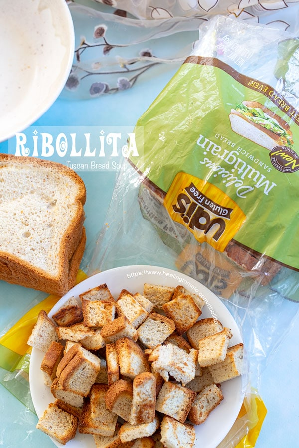 - Overhead view of bread cubes in a bowl with UDI bread package in the back