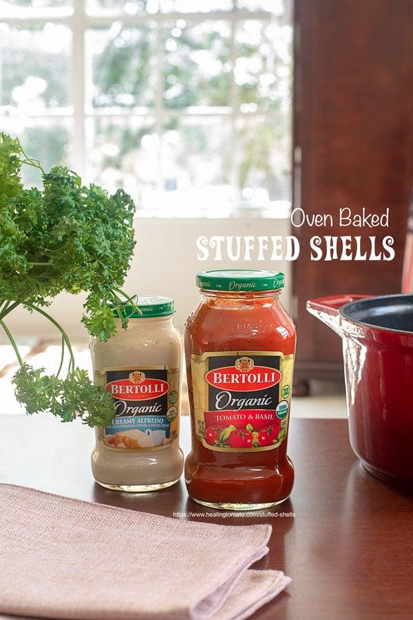 Front view of Bertolli tomato sauce and bertolli alfredo sauce