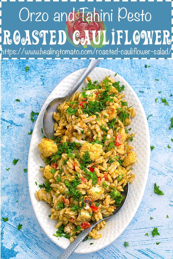 Easy, Warm Vegan Roasted cauliflower salad with roasted red peppers and orzo in a basil pesto tahini sauce. This salad recipe makes me fall in love with cauliflower all over again. #healingtomato #cauliflower #salad #vegan #orzo #cauliflowersalad