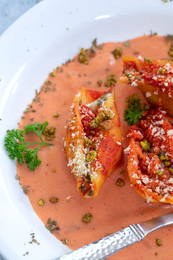 Closeup view of stuffed shells in rosa sauce
