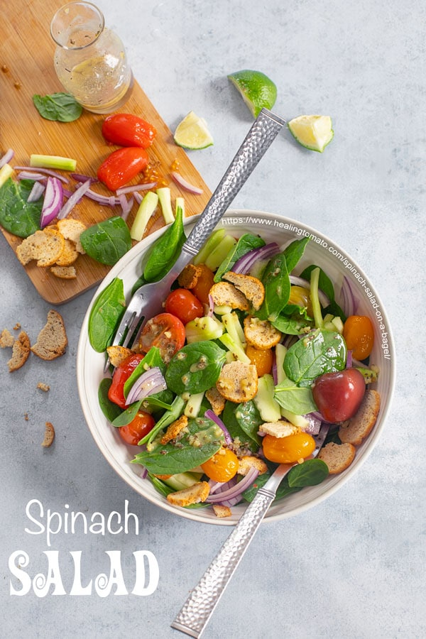 Overhead view from the top of spinach salad bowl with dressing
