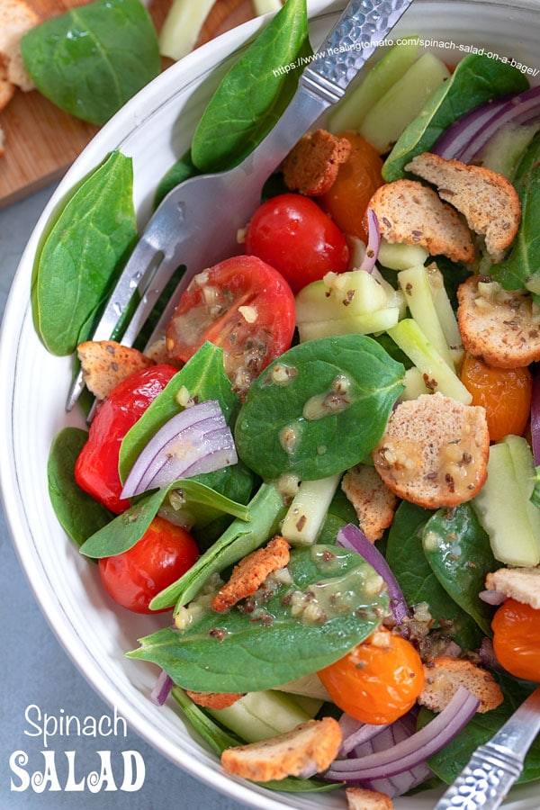 Closeup view from the top of spinach salad bowl with dressing