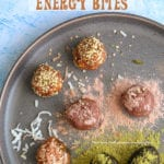 Overhead view of 7 no bake energy bites on a dark grey plate