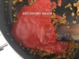 tomato sauce added to pan