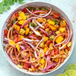 Kachumber is a no oil, spicy, easy cucumber salad with tomatoes, mangoes, onions and Indian spices. Served alongside Indian Food #healingtomato #kachumber #tomatosalad #cucumbersalad #indiansalad