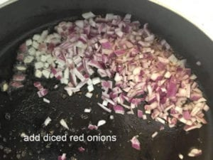 diced red onions added to the pan