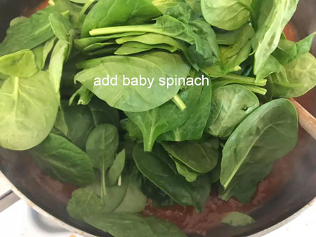 baby spinach added to the pan
