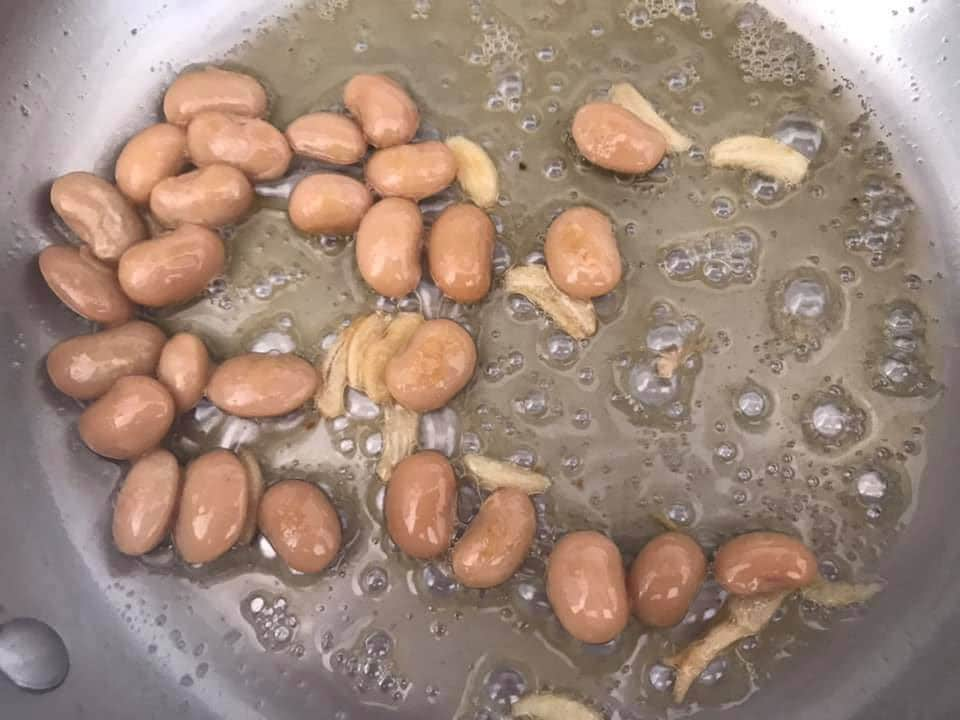 butter beans added to the pan with butter and garlic
