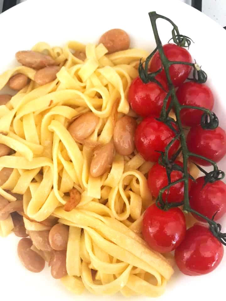 plated fettuccine Pasta with cherry tomatoes on the right side