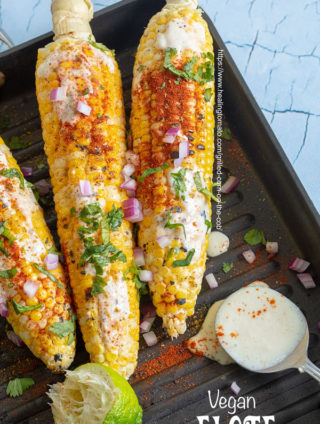 Top view of 3 grilled corn on the cob on a calphalon stove top grill