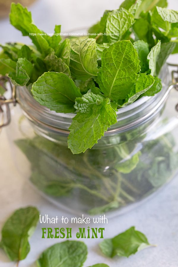 Closeup view of a mason jar filled with fresh mint