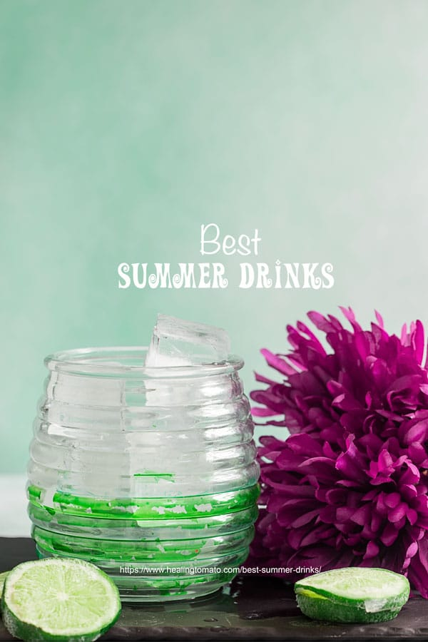 Front view of a green and white ridged glass filled with water and ice cubes - Best summer drinks
