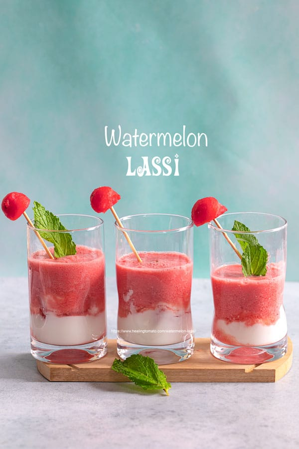 Front view of 3 small glasses filled with watermelon lassi and a yogurt layer at the bottom