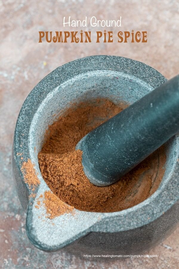 closeup view of ground pumpkin pie spice in a mortar and pestle