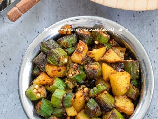 Top view of okra and potatoes in a bowl