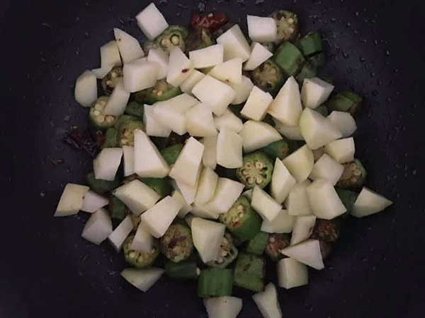 potatoes added to the fry pan with okra