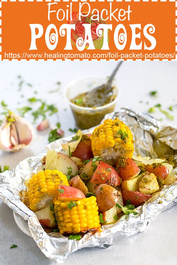 Foil pocket grilled potatoes and corn flavored with basil pesto #healingtomato #foilpacket #grilledcorn #potatoes #vegetables @healingtomato