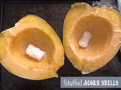 2 Acorn halves with a butter piece inside each