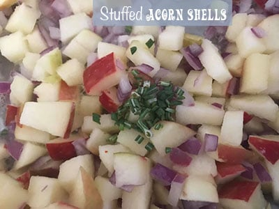 Top view of chopped rosemary on diced apple and onions