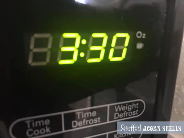 The timer on the microwave showing cook time of 3:30
