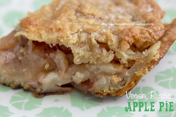 Closeup view of a slice of apple pie from the side
