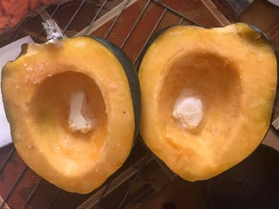 Acorn halves with vegan butter piece inside each