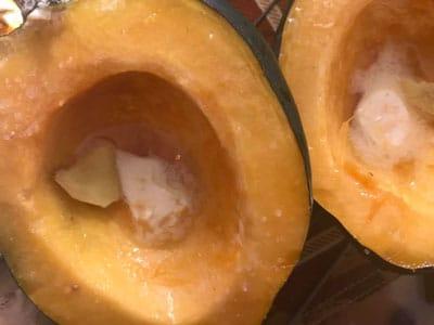 maple syrup brushed over acorn squash