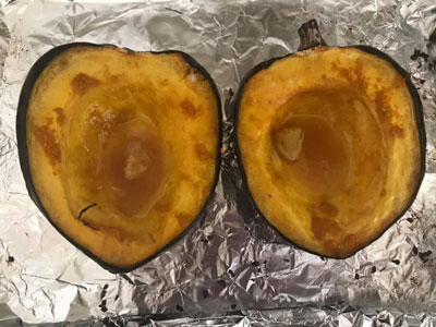 roasted acorn squash coming out of oven