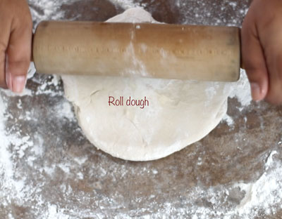 dough being rolled into a a round pie crust