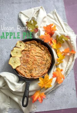 top view of a baked apple pie in a cast iron pan