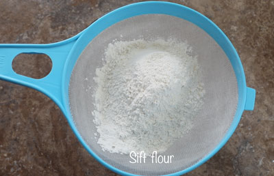 flour on a blue nylon strainer