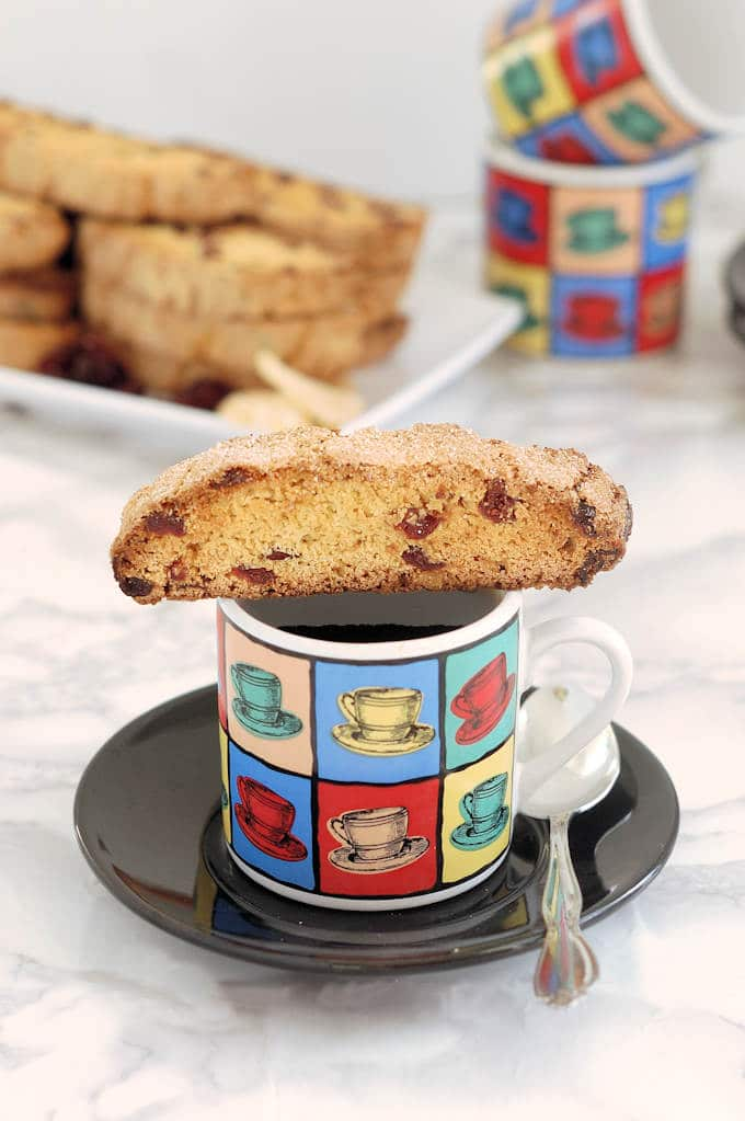 front view of a single biscotti on top of a coffee mug by Soup Addict