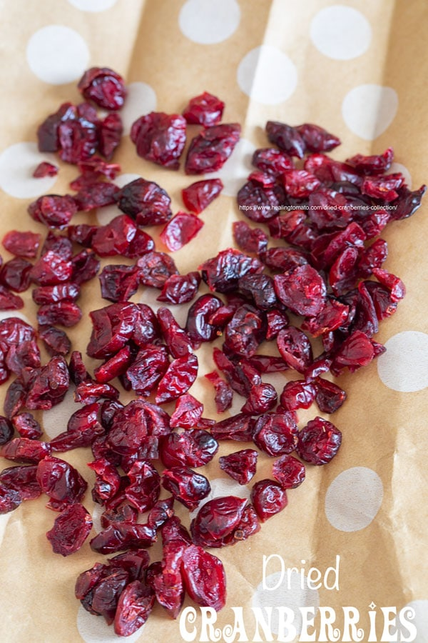 top view of dried cranberries on a brown and white polka dot paper