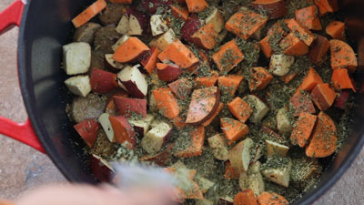 Top view of dried spices add to the ingredients in the Dutch oven