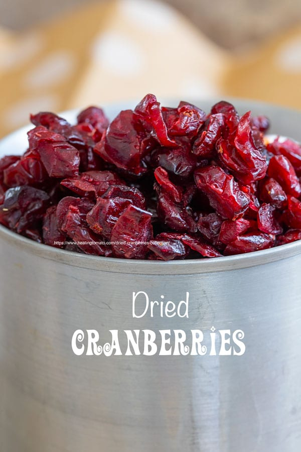 closeup view of dried cranberries in an aluminium cup