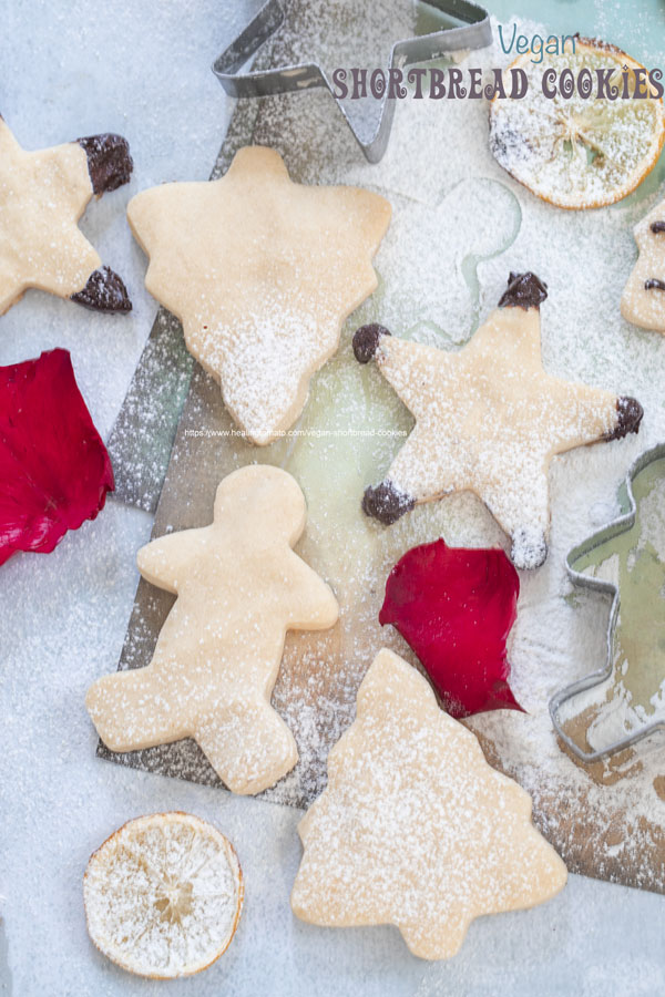 Top view of vegan shortbread cookies shapped like stars, gingerbread man and Christmas tree