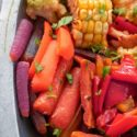 Closeup view of roasted carrots, bell pepers and corn